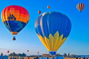 Picture of hot air balloons lifting off